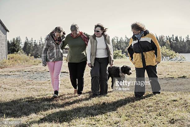 four cheerful family women walking and talking - fat granny stock pictures, royalty-free photos & images
