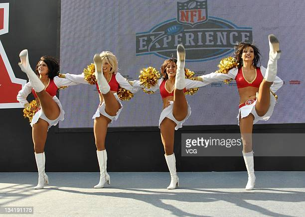 Four cheerleaders of the San Francisco 49ers cheers perform during the 'NFL Experience' at Shanghai Stadium on November 27 2011 in Shanghai China