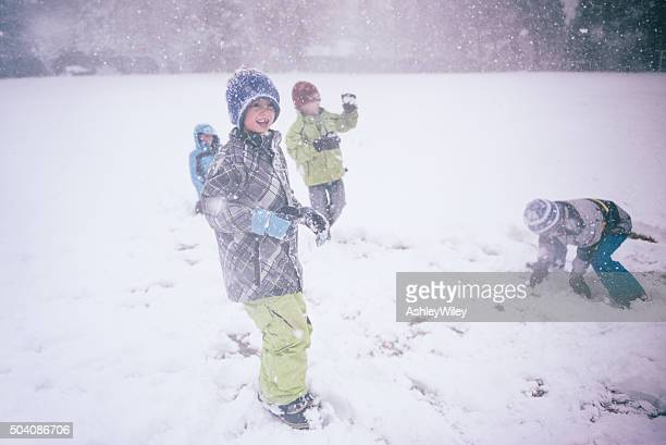 Four children in a snowball fight