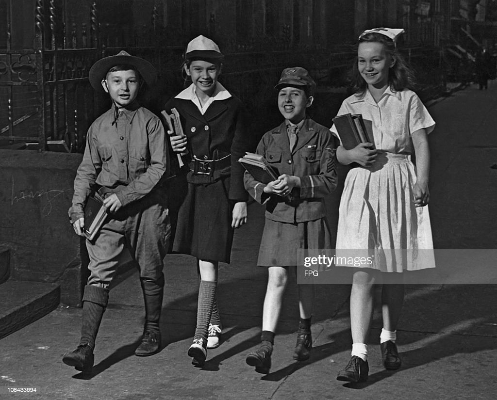 Four children in military and nursing uniforms on the way to