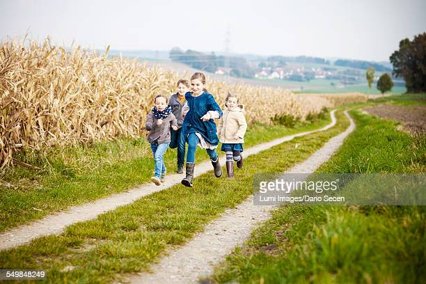 Four children playing outdoors