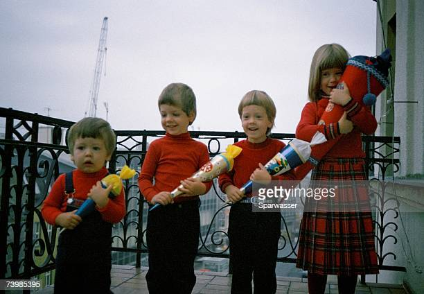 four children standing in a row - first occurrence stock pictures, royalty-free photos & images