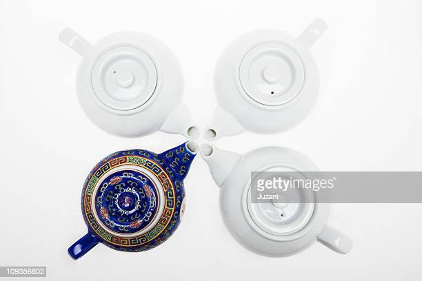 Four Chinese tea pots facing one another