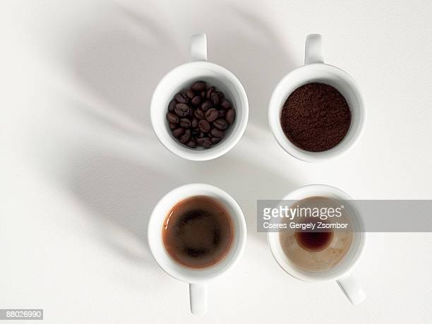 Four coffee cups with beans, ground, brewed coffee