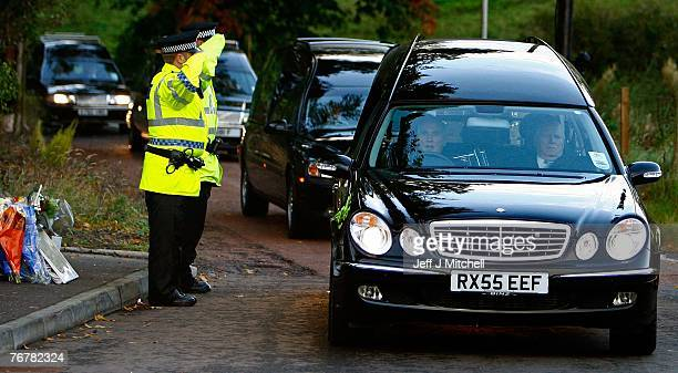 Four coffins from Saturday's helicopter crash near Lanark are taken away from the scene in hearses September 16 2007 in Lanark Scotland The former...