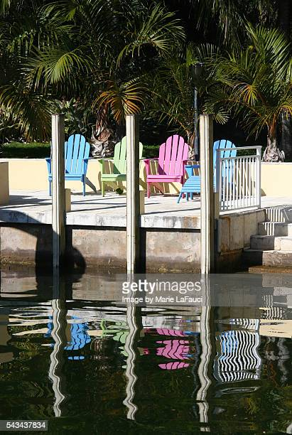 four colorful adirondack chairs on the dock by the ocean - marie lafauci stock pictures, royalty-free photos & images