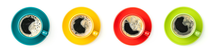 Four colorful coffee cups on a white background 1069136628