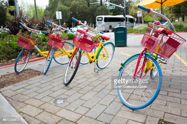 Four colorful Google Bikes in a line at the Googleplex the Silicon Valley headquarters of search engine and technology company Google Inc Mountain...