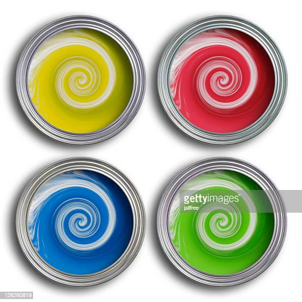 Four coloured paint tins with swirling paint