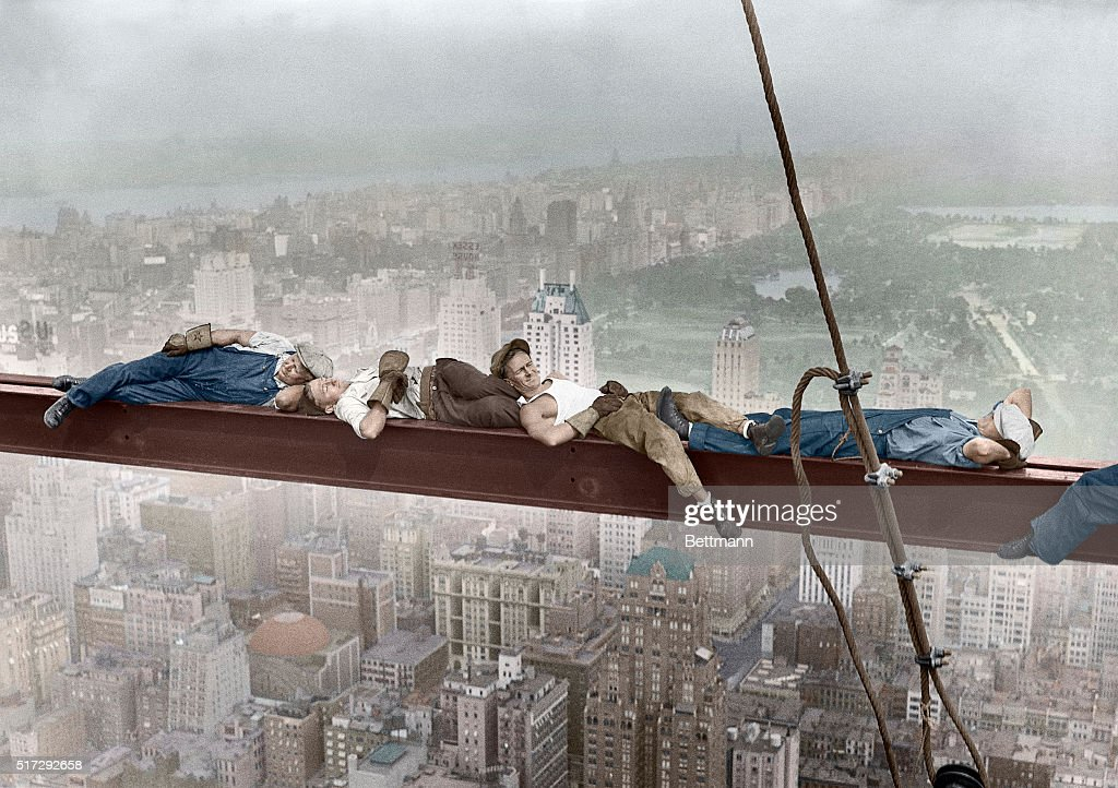 Construction Workers Resting on Steel Beam Above Manhattan : News Photo