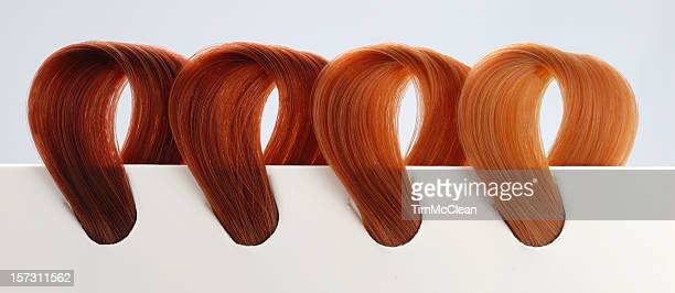 four copper tone hair swatches