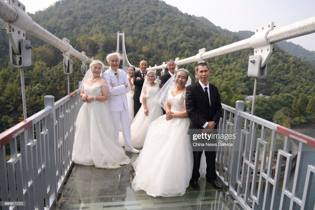 Four couples celebrate golden wedding anniversary on glass bridge