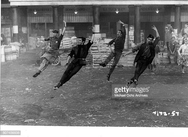Four Covent Garden Market porters join in the dance 'Operas and Oranges' in the musical movie 'Three Hats for Lisa' circa 1966