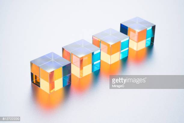 four cube prisms - four objects stock pictures, royalty-free photos & images