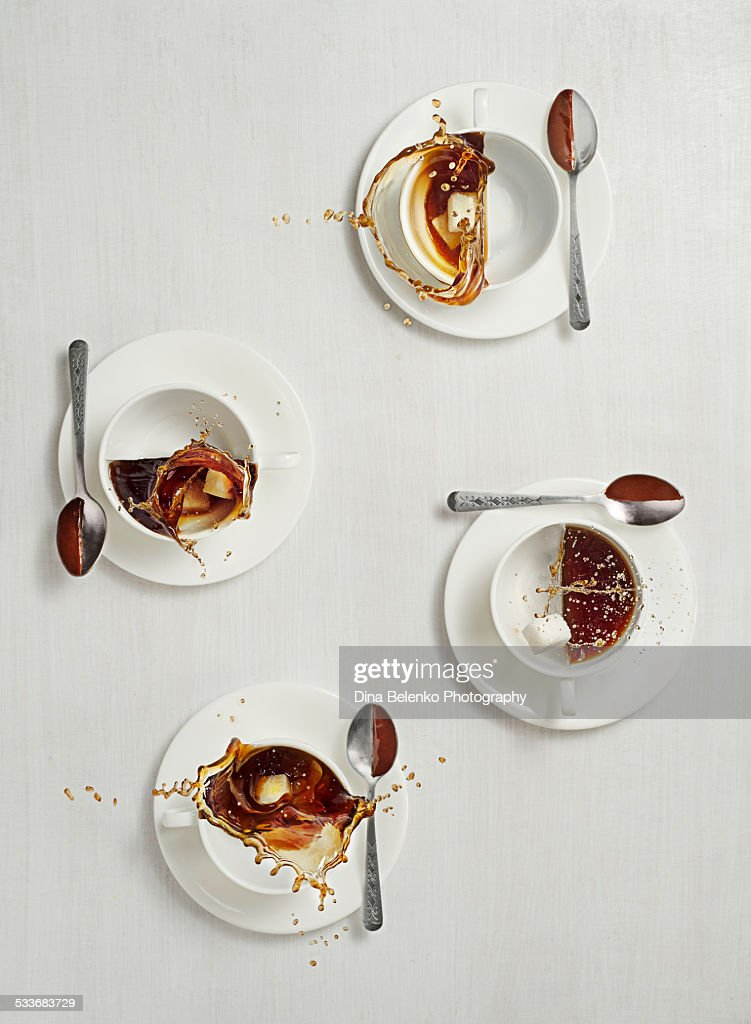 Four cups of coffee with splashes : Foto stock