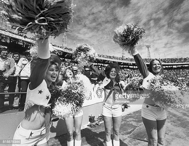 Four Dallas Cowboys cheerleaders cheer their team in the 1976 Super Bowl in Miami Many men leer from the stands behind them