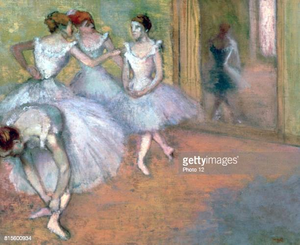 Four Dancers in the Foyer' Members of the corps de ballet in tutus chatting Edgar Degas French Impressionist painter