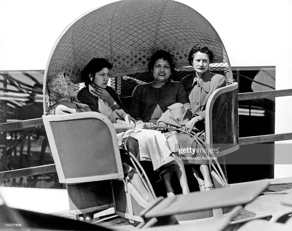 Four decidedly unenthusiastic women on a Tilt-A-Whirl carnival ride at Playland At The Beach in San Francisco, California, 1955.