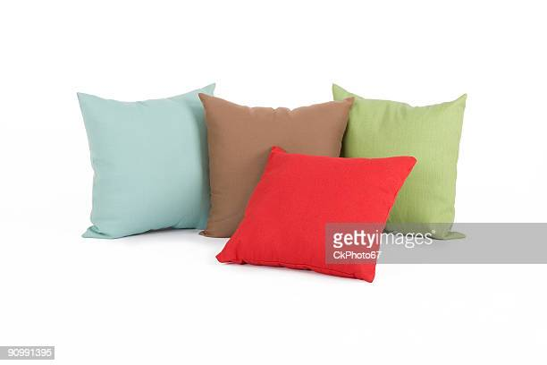 Four different colored pillows