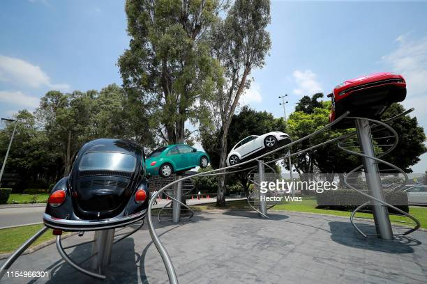 Four different historic Beetles are seen during a ceremony to announce the cease of the production of the VW Beetle after 21 years in the market at...