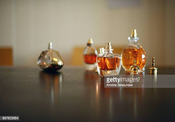 four different perfume bottles