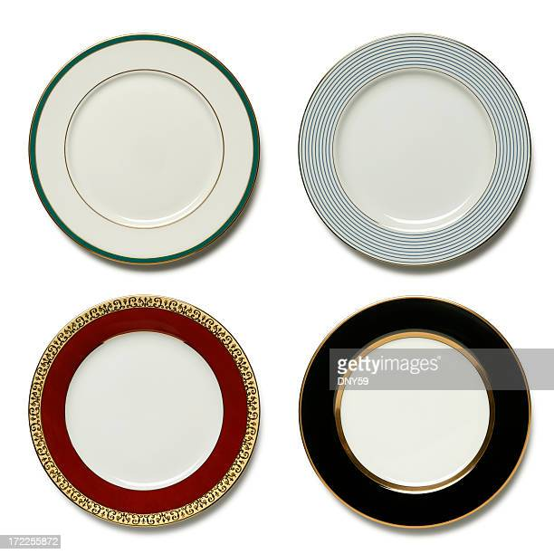 Four dinner plates on white background