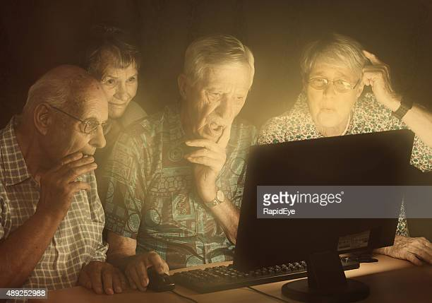 Four disappointed seniors, lit by computer monitor, fail at technology