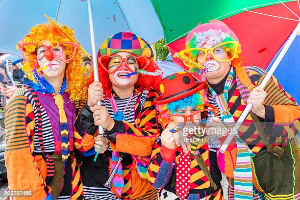 Four dressed as clowns at the Carnaval in Prado, Portugal