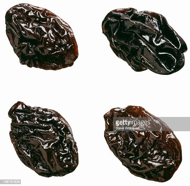 Four dried plums or prunes