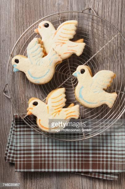 four easter dove biscuits - colomba pasqua foto e immagini stock