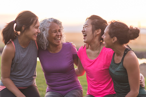Four ethnic women laughing together after an outdoor workout - gettyimageskorea