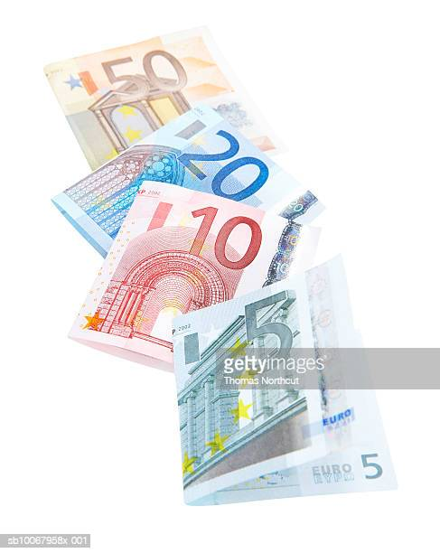 four euro banknotes - five euro banknote stock photos and pictures