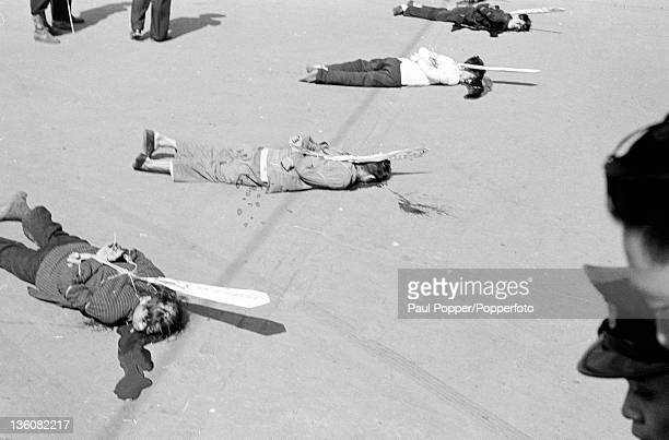 Four executed Chinese prisoners moments after being shot for economic racketeering in Shanghai circa May 1949 Attached to each prisoneer is a paper...