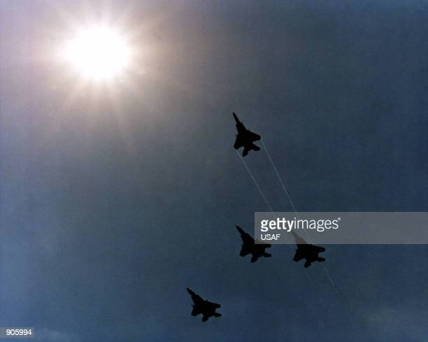 Four F15 Eagle aircraft execute a Missing Man formation as they fly over the Pentagon during Memorial Day services
