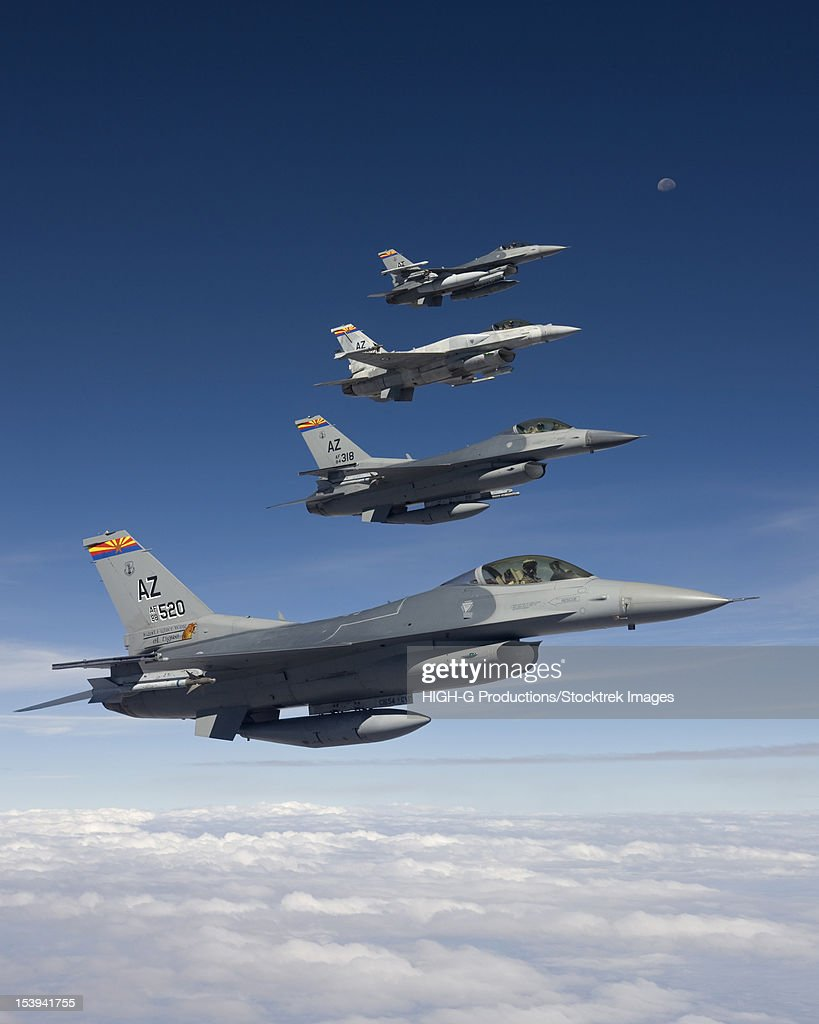 Four F-16's stationed at the 162nd Fighter Wing in Tucson, Arizona, fly in formation during a training mission. : Stock Photo