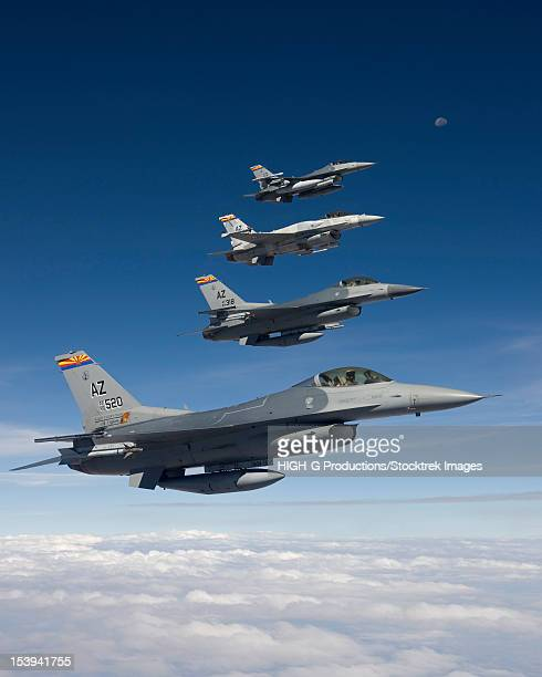 four f-16's stationed at the 162nd fighter wing in tucson, arizona, fly in formation during a training mission. - us air force stock pictures, royalty-free photos & images