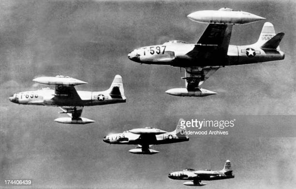Four F80 jet fighters flying at 30000 feet on their flight from a Japanese base to their mission against the North Korean Communist army columns...