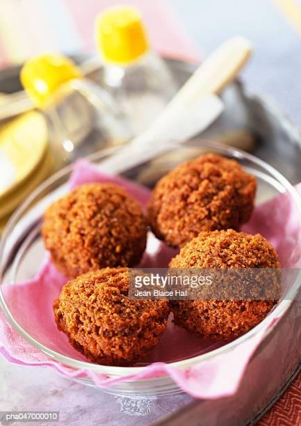 Four falafel balls in bowl, close-up