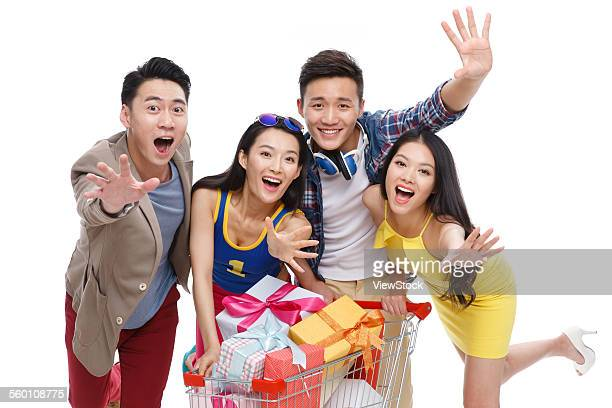 Four fashion of young people and the shopping cart