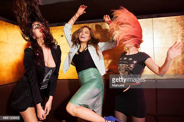 four female friends dancing in nightclub - ladies' night stock pictures, royalty-free photos & images