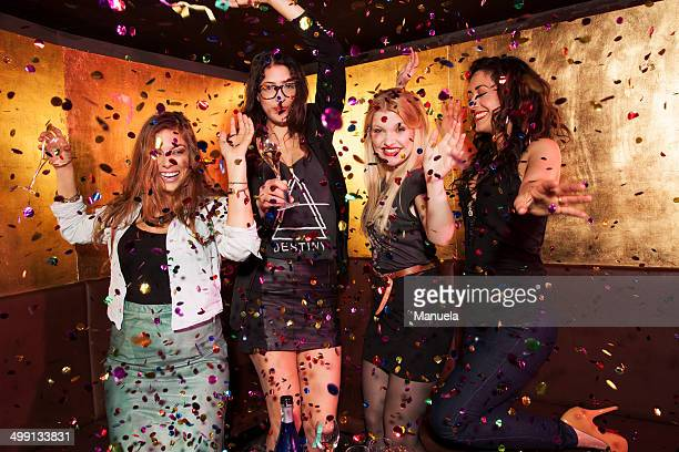 Four female friends partying in nightclub