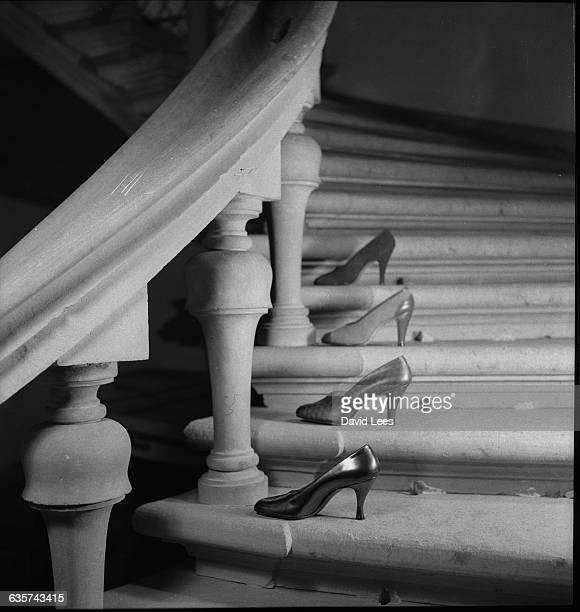 Four Ferragamo shoes placed on a staircase