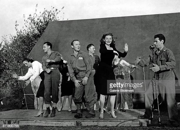 Four French actresses are dancing with American soldiers on stage 1944 La Cambe Normandy France
