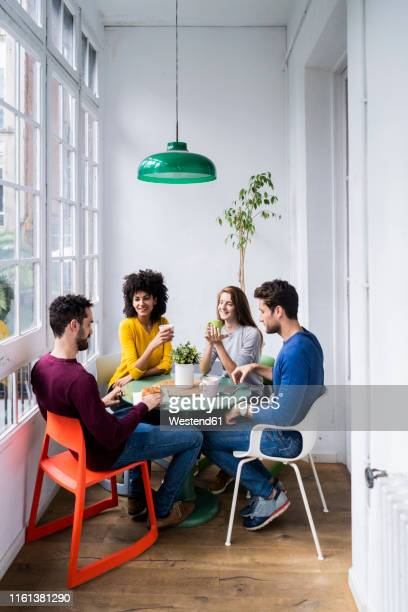 four friends at home having coffee break - frauen über 30 stock-fotos und bilder
