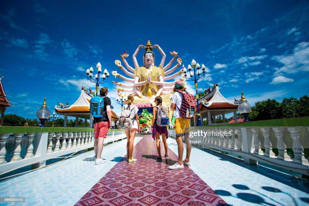 Four friends exploring Thailand : Stock Photo
