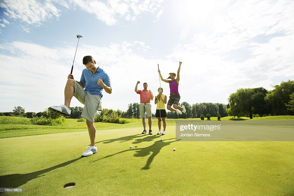 Four friends golfing together. : Stock-Foto