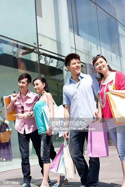 Four Friends Holding Shopping Bags
