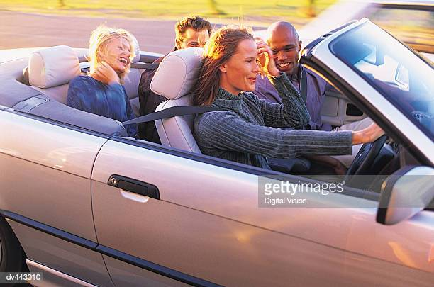 four friends in a car - four people in car stock pictures, royalty-free photos & images