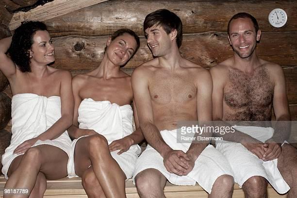 Four friends in a sauna