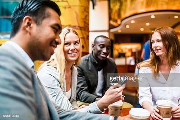 Four friends in Hong Kong cafe